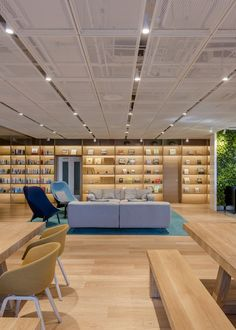 Image 5 of 14 from gallery of NIO House / AIM Architecture. Photograph by Dirk Weiblen Showroom Design, Office Interior Design, Office Interiors, Commercial Design, Commercial Interiors, Office Ceiling, Ceiling Treatments, Library Design, Color Tile