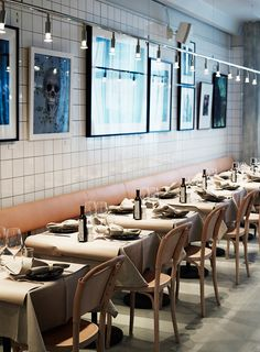 Leather Banquet Seating and grey tablecloths at Stockholm's AG restaurant.
