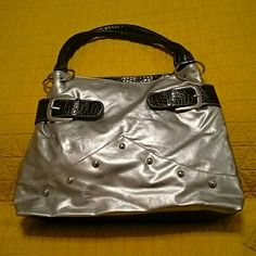Purse /Handbag This is a cute silver purse /Handbag with silver button decorations on the front. EUC. Unknown  Bags Shoulder Bags
