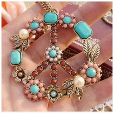 """Colorful BoHo Hippy Peace Necklace Bronze Tone NEW Beautiful Peace Sign Bronze Tone Fashion Pendant Necklace. Decorative Faux Pearl, Turquoise and Beads. Over sized European Style Peace Sign 2""""x2"""". Chain measures 26"""" w/Lobster Style Clasp. NEW. You will love the Vintage feel! Please see my other items and save more when you bundle. Thank you for browsing my closet. Boutique Jewelry Necklaces"""