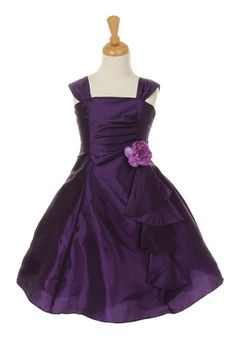 Girls Short Purple Dresses with Ruffled Skirt are a must have for girls who want to look pretty during a wedding or any formal event. Made out of taffeta, the purple dress features a long ruffled skir                                                                                                                                                                                 More