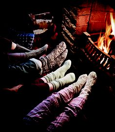 Snuggling by the fire....ahhhh. Nice!