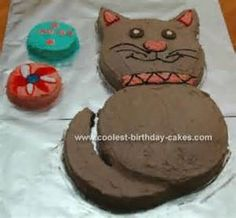 Cat Cake with cut pieces. With cute colors though!