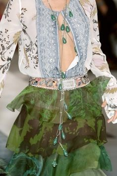Christian Lacroix. I would use the buttons on the blouse.  LOL TG