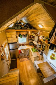 The house, which he designed himself, sits atop an 18-foot trailer and features beautifully finished wood almost all over, which makes an especially warm combination with the exposed copper pipes inside.  #TinyHouseforUs