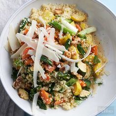 Crisp yellow squash shines alongside a medley of fresh sauteed veggies and a base of quick-cooked couscous in this easy summer squash recipe. A lime dressing ties the dish together with a touch of Parmesan and a handful of walnuts for texture. /