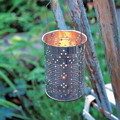 Make these DIY Tin Lanterns that cast ambient light.