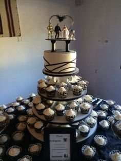 Wedding cake and cupcakes:). Star Wars topper:)