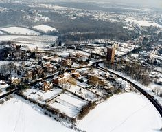 Aerial view of the Benfleet water tower in the snow.  The water tower is a well-known local landmark, sitting at the top of a hill. The road to the lower right is Essex Way, that to the mid-left is Vicarage Hill (the vicarage is at the bottom). The road to the upper right of the tower is Benfleet Road, leading to Hadleigh.