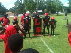 Youngsters at Lakeshore Athletic Assoc wearing new uniforms provided by Tim Tebow Foundation (July 28, 2012)