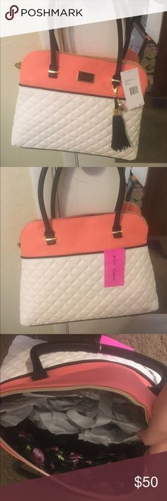 Brand New Betsy Johnson Bag Super cute black, white, and peach Betsy Johnson Purse. I love it but I'm much more into small purses now so it has just sat in my closet. BRAND NEW.. Still has tags Betsey Johnson Bags Shoulder Bags