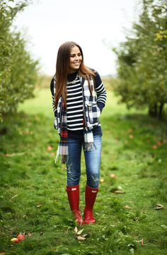 layered fall look.  navy buffalo vestm striped sweater red boots tartan scarf