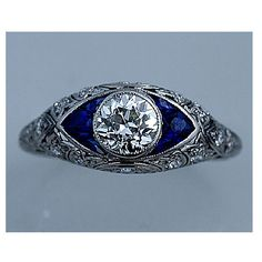 This is amazing it looks like an evil eye! Art Deco Platinum Old European Cut Diamond Engagement Ring Circa Early 1900's