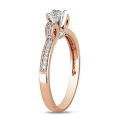 @Overstock - Crafted from 14-karat rose gold and bearing 1/2-carat total weight in diamonds, this beautifully feminine pink gold diamond engagement ring is a unique treasure. The radiant round center diamond sits atop a curved band for more intense sparkle.http://www.overstock.com/Jewelry-Watches/Miadora-14k-Rose-Gold-1-2ct-TDW-Diamond-Bow-Ring/4820042/product.html?CID=214117 $891.99