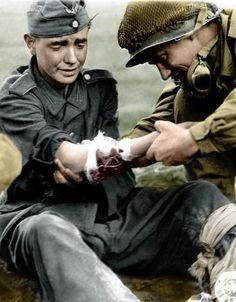 American medic treats young German soldier during WWII in 1945