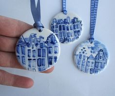 This hand formed porcelain pendant is hand painted in the traditional Dutch Delft technique using cobalt oxide and has a strong transparent gloss glaze.  Fired on high temperature.  It measures 2,5 inch or 5 cm. in diameter and and hangs from a a blue ribbon.  Comes in a cute gift box with numbered product card.
