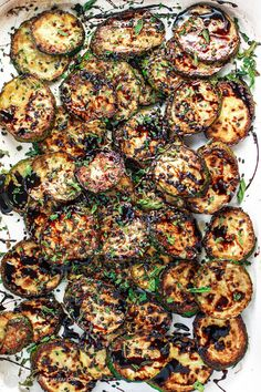 Easy Skillet Zucchini Recipe with Balsamic Reduction   The Mediterranean Dish. This is simply the best side dish! Zucchini rounds sauteed in olive oil and finished with a sweet balsamic reduction, black sesame seeds and a sprinkle of mint flakes. Perfection in minutes!