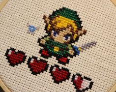 Handmade Link with Navi and hearts cross stitch in a 4 inch hoop. Easy to hang by the closure at the top. Perfect little gift for any Legend of Zelda fan before the new game hits stores