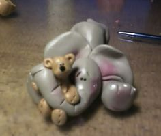 Claykeepsakes (facebook page) Polymer clay elephant with his teddy bear