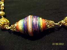 Focal paper bead for necklace.