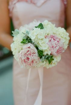 Brides.com: . Bridesmaid Bouquet of Hydrangeas and Peonies. This lush arrangement of white hydrangeas and pink peonies pops against blush colored bridesmaids' dresses.  See more photos from this preppy Washington D.C. wedding.
