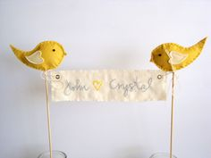 Love Birds Wedding Cake Topper- personalized banner with bride groom names, initials and felt birds in your colors. $45.00, via Etsy.