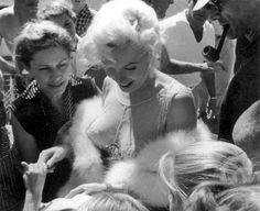 "Marilyn Monroe signing autographs on the set of ""Some Like It Hot"" (1959)"