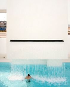 waterfall pool, Les Bains Des Docks Aquatic Center in Le Havre, France. Designed by Ateliers Jean Nouvel.