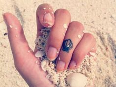 16 Tiny Tattoos With BIG Meanings