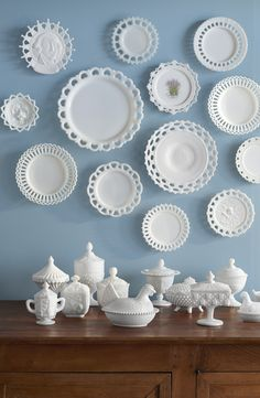 Beautify dining room walls by hanging decorative milk glass dishes.