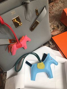 38b729154c99 Hermes releases a limited edition of horse hair rodeo charms. PurseBop  examines the bag charm phenomenon across all brands.