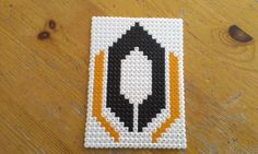 """Mass Effect Cerberus by RavenTezea.deviantart.com on @deviantART  My brother asked me to do the Mass Effect Cerberus logo, my answer was """"The mass-what-did-you-say...?"""" So he gave me a pic... xD  My own design :meow:  Made with Nabbi perler beads"""