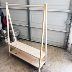 DIY: Kids Wood Clothing Rack - This Bliss Life <br> Need a space for dress up clothes or costumes? Learn how to build a kids wood clothing rack otherwise known as an open wardrobe! Diy Clothes Rack Wood, Wood Clothing Rack, Kids Clothing Rack, Clothes Racks, Diy Clothes Storage, Dress Up Storage, Diy Clothes At Home, Retail Clothing Racks, Clothing Organization
