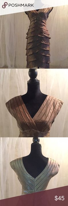 Adrianna Papell Gold Dress Beautiful gold dress with a shimmering effect. Lined skirt, unlined top. You will need a slip or nude bra. Zip back. Beautiful condition. No trades. Adrianna Papell Dresses