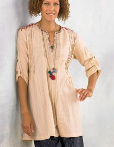 Kamini Tunic - Natural. Best-selling tunic length style features pin-tuck detailing, whimsical hand embroidery at shoulder and contrast binding at neck and back tie. This is a real artisan piece to collect. 100% cotton.