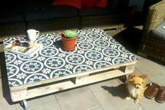 Pallet Table with tiled top and lockable wheels.