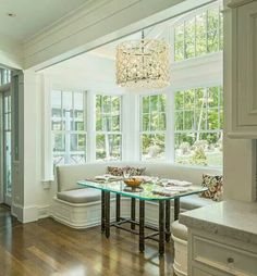 Window booth breakfast nook. Floor to ceiling windows, but I would prefer a more modern or rustic wood table