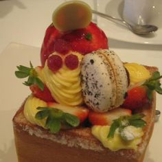 Honey toast- fruit, ice cream, macarons, and custard~  Party of flavors, perfect for afternoon tea :)