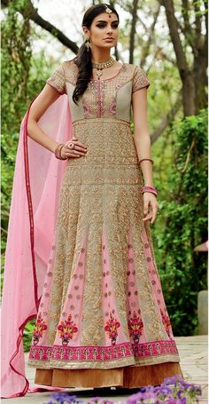 Look resplendent in this heavy gown style Pink Anarkali that has zardosi and pita work. It has a very ethnic and Grand vibe to it. The pink color adds femininity and delicacy to the entire look.