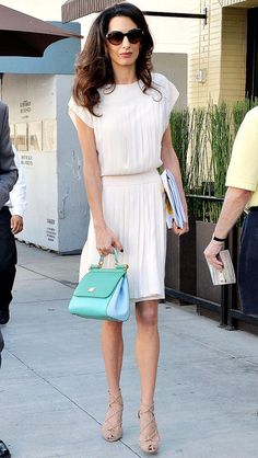 Amal Clooney's Street Style: Every Can't-Miss Outfit | Cream pleated dress and Dolce & Gabbana blue color-block bag