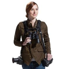 Fixed on the shoulder of a double strap, BinocStrap helps bring binoculars comfortably along with two cameras.