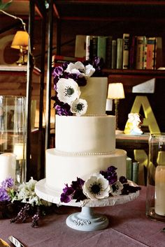 Sugared Anemones Wedding Cake - Uniquely Southern Wedding Cakes - Southernliving. Purple and white sugared anemones give the cake a modern touch.    Love It? Get It!Vanilla Bake Shop