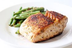 Baked Herbed Salmon - The secret to crispy, flavorful salmon with an extremely tender inside.
