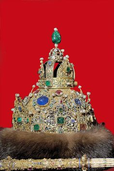Diamond Crown of Peter the Great, composed of gold, silver, diamonds, emeralds, rubies, tourmalines, sable, and enamel. One of two ceremonial crowns, each set with about 800 diamonds, made for 15-year-old Ivan V (1667 - 1696) and his younger half-brother Peter I (1672 - 1725) , in 1682. It is decorated with a gold two-headed eagle, the Russian emblem, beneath a crown and rosettes of flowers. Large polished emeralds and rubies adorn the crown.