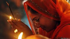 A Hindu woman holds incense sticks as she offers prayers inside the Alopi Devi temple in Allahabad. Hindu New Year is celebrated Friday, the first day of Navratri, or nine nights festival that honors Hindu goddess of valor, Durga. Indian New Year, Hindu New Year, Pilates, Garba Dance, Black Buddha, Black Hebrew Israelites, Award Winning Photography, Mother Goddess, Black History Facts