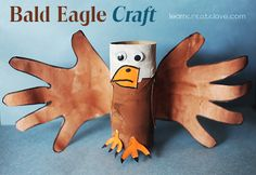 Bald Eagle craft made from toilet paper rolls and little hand prints