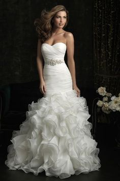 Photo by: Allure Bridals  7. Allure Bridals  For va-va-voom curve appeal, consider a ruffled mermaid, like this one by Allure Bridals. Asymmetrical pleats on the bodice coupled with a sparkling belt create a flattering shape.