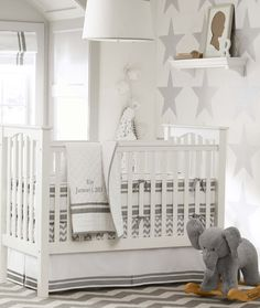 Don't go overboard with the elephant theme. Soft greys in a variety of patterns provide an inviting atmosphere for a nursery