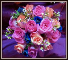 Bouquet of Topaz roses, High and Booming roses, Blue anemones and waxflower.