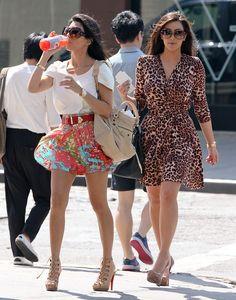 Kourtney ( floral print skirt) and Kim Kardashian Animal Leopard Print dress.